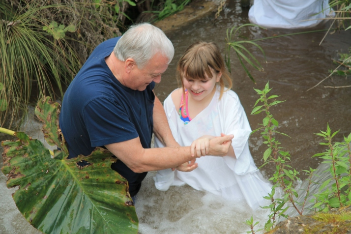 Zoë being baptized