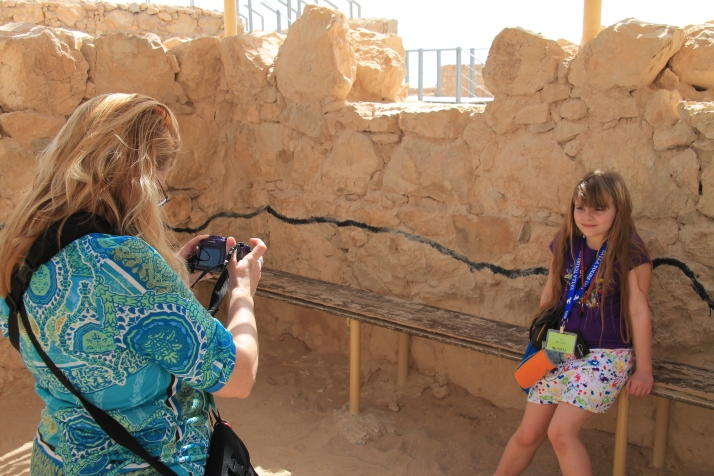 Zoë has her picture taken on Masada