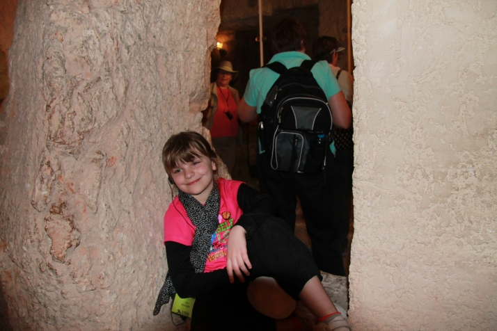 Zoë poses in a cave under the House of Caiaphas