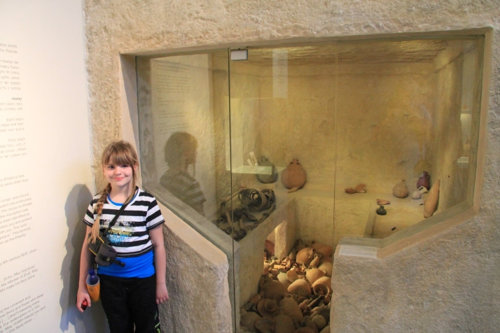 Zoë in front of the exhibit of a First Temple Era Tomb.